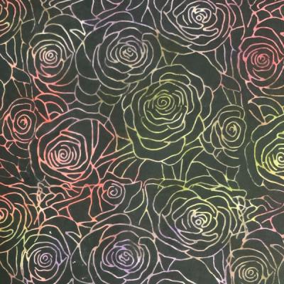 Multiple roses on black batik